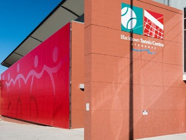 Blacktown tennis centre featuring Arrow Metal's red perforated metal mural