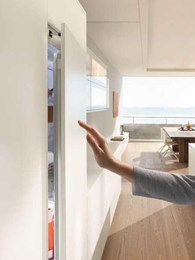 Blum's new SERVO-DRIVE flex for integrated appliances easing door opening