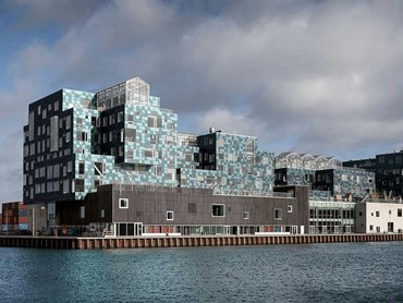 There are several noteworthy elements of the new Copenhagen International School (CIS) building. It's the city's largest school, located on a prominent site by the water in the new Nordhavn district, and looks more like a stack of mismatched shipping containers than a traditional campus. Images: Supplied