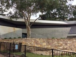 Fire curtains provide protection to NSW bushland home's feature glass