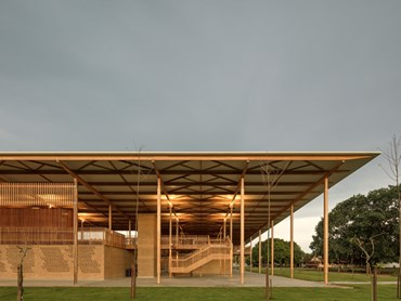 The Children Village comprises two identical structures—one for male students and one for female students—defined by a huge timber roof. This roof canopy is supported by glue laminated timber beams and columns, which is an uncommon material for the region. Images: Supplied