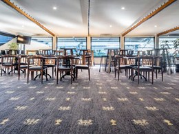 Custom carpet with club's branding creates a memorable upmarket look