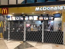 Access control barriers ensure social distancing at McDonald's restaurants