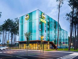 Danpal facade system helps hotel merge with forest landscape