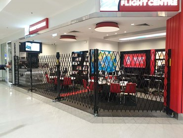 Flight centre shopfront movable security barrier