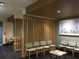 Gran Associates warm hospital waiting room with timber slats and beams