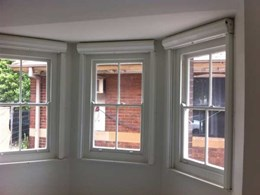 Windowshield fire shutters used for heritage building retrofit in Green Square, Alexandria