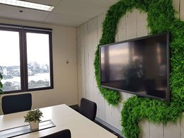 Corporate logo created from fern leaf green wall panels