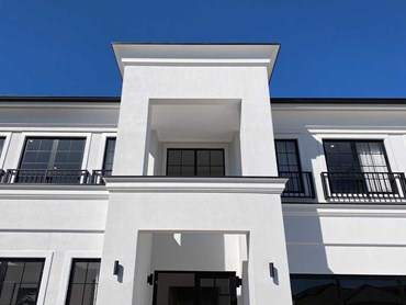 Ascot Home featuring a white double-storeyed French Provincial façade