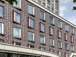 4-star hotel converted from an office building features Corium brick cladding