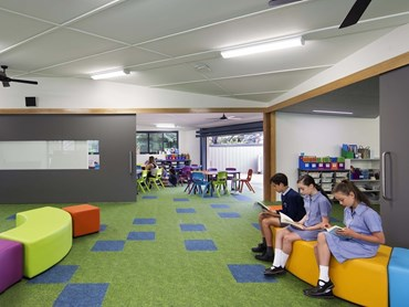 Through visual variation in floor finishes, Harrison & White and Paul Coffey Architects aimed to integrate, yet differentiate internal and external spaces at St. Bernard's Primary School, Year 5&6 Learning Hub, Victoria. Photography by Ben Hosking