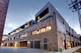 Beauty and the beast: Cargo Apartments marry brick warehouse with luxurious fitout