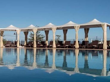 Poolside Cabanas: Rich Agora curtaining with Précontraint 502 conical canopies