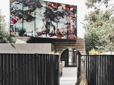 Large panels of structural glazing provide the canvas for artistic images