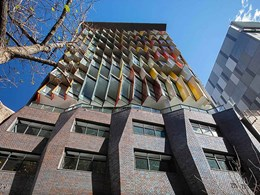Patterned façade created with brick inlay on 14-storey Sydney building