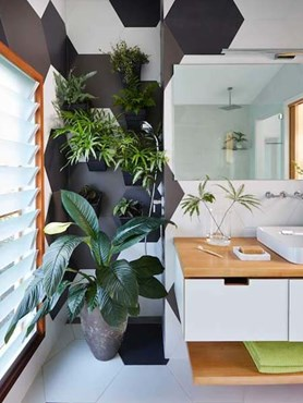 Compact bathroom with oversized tiles and space-saving Kohler bathroom fixtures
