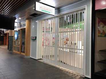 Krispy Kreme shop front with security shutters