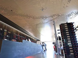 Custom perforated ceiling panels meet complex brief for iconic winery