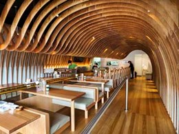 Plywood beams customised for acoustic feature ceiling at Maroubra restaurant