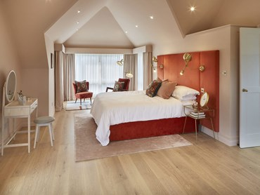 Mill House bedroom featuring Champagne flooring