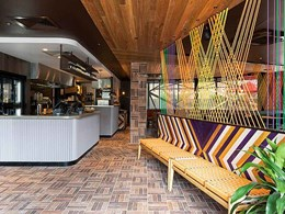 Ochre brick tiles add authenticity and contrast to revitalised Nando's Clayton