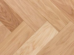 New natural wood floors featuring a herringbone pattern