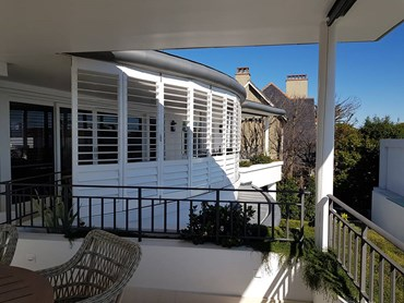 Openshutters plantation shutters in residential patio