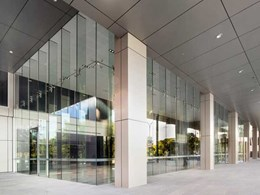 Custom laminated 7m fins from Cooling Bros achieve striking glass design at Perth office building