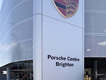 Perforated metal helped Porsche achieve their distinct brand look, while keeping the building sunny