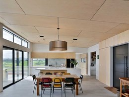 Natural materials create seamless indoor-outdoor flow at Pukekohe home