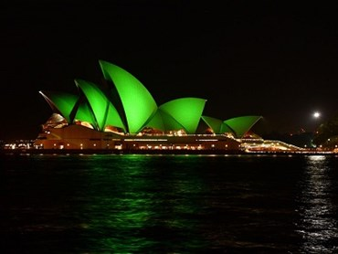 Sydney Opera House sails lit green