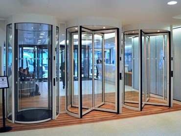 Revolving doors exclude threats while allowing smoothly regulated traffic flow