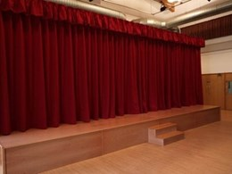 Custom-made stage curtains and valances by Select Concepts dress up performance spaces