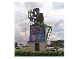 Kennards Hire 12 metre trailer lifts used to paint football jumper on statue on Gold Coast