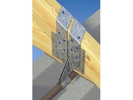 MiTek BlockFast strap holds down roof truss to concrete masonry walls