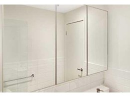 Mitchell Laminates supplies 650 AliFrost vanity mirror doors for Melbourne apartment complex