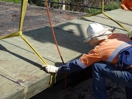 New plywood bridge deck system rehabilitates old timber bridges