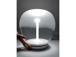 New table lamps from Artemide combine traditional blown glass with LED tech