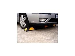 Recycled rubber and plastic wheel stops available from Barrier Security Products