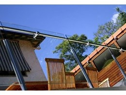 Side-mounted balustrade handrails deliver a soft and sophisticated style with uninterrupted views