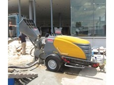 Toto Tooling use concrete grout and screed mixer pump from Kennards Concrete Care to cut job time