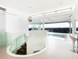 Unique 3-level stair in award-winning home redefines role of glass