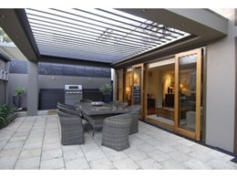 Vergola's opening roof system keeps outdoor living areas comfortable in winter