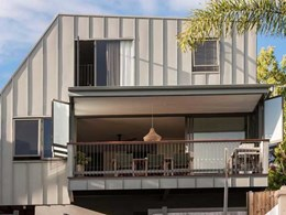 Single lock standing seam zinc facade adds contemporary edge to traditional QLD home