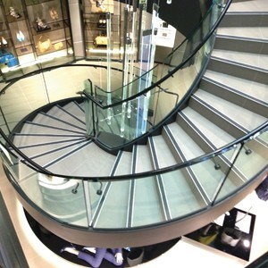 Stunning stair design with curved glass balustrades at Hugo Boss Sydney