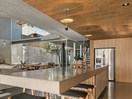 Feature lighting complements raw finishes at Perth residence