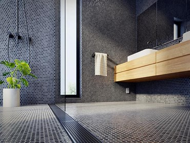 Stormtech Marc Newson designed black linear drains in modern bathroom