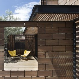 Wooden bricks clad the Stonewood house by Breathe Architecture