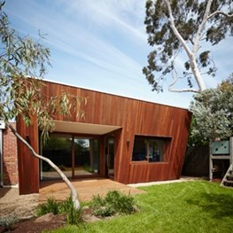 Angled timber-clad facade boosts passive solar design of this house by Mesh Design + Projects