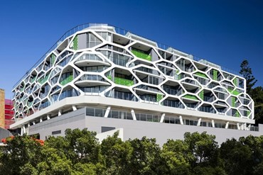 The Alpha by Tony Owen Partners mimics nature's structures with hexagonal pod facade